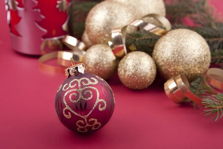 beautiful golden christmas decoration on red background sparkle photo
