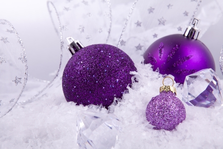 purple metal: beautiful christmas decoration in purple and silver on white snow sparkle