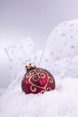 beautiful gold and red christmas decoration on white snow sparkle Stock Photo - 14644501