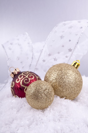 beautiful gold and red christmas decoration on white snow sparkle Stock Photo - 14644575