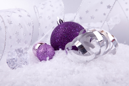 beautiful christmas decoration in purple and silver on white snow sparkle stock photo 14645280