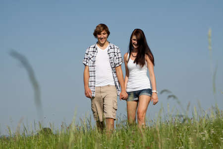young love couple smiling outdoor in summer having fun Stock Photo - 14796221