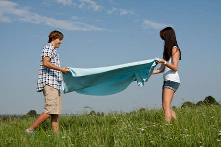 young couple outdoor in summer on blanket in love Stock Photo - 14796236