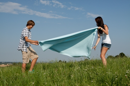 young couple outdoor in summer on blanket in love Stock Photo - 14796237