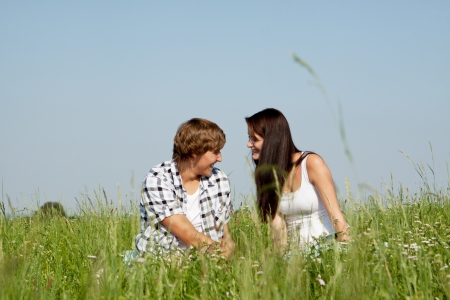 young couple outdoor in summer on blanket in love Stock Photo - 14796226