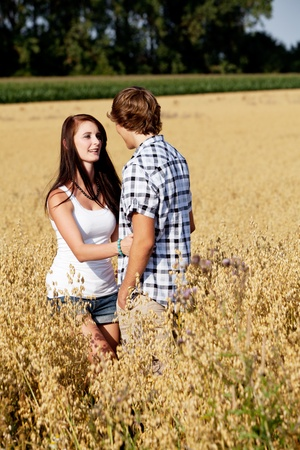 happy couple in love outdoor in summer on field having fun photo
