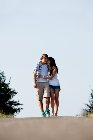 young woman and man is walking on  a road in summer outdoor happy photo