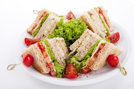 chicken sandwich: fresh tasty club sandwich with lettuce cheese ham and toast isolated on white background Stock Photo