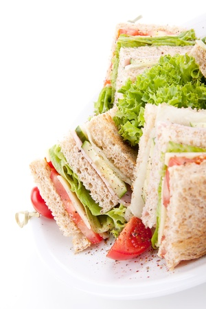 fresh tasty club sandwich with lettuce cheese ham and toast isolated on white background Фото со стока