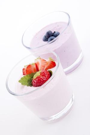 fresh tasty strawberry blueberry yoghurt shake cream isolated  on white background