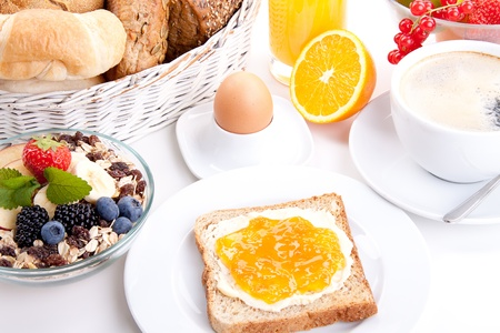breakfast table with toast and orange marmelade isolated on white background photo