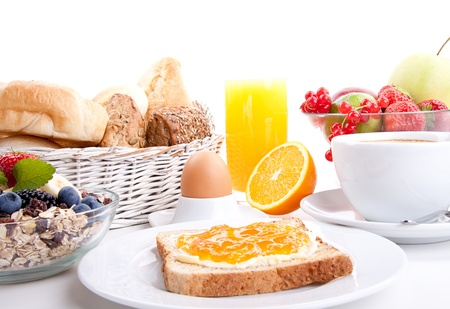 wheat toast: breakfast table with toast and orange marmelade isolated on white background Stock Photo