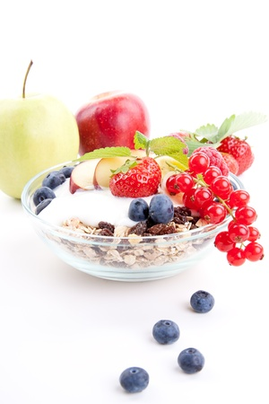 deliscious healthy breakfast with flakes and fruits isolated on white background photo