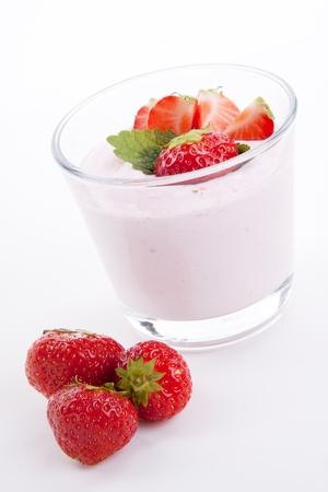 eating yogurt: fresh deliscious strwaberry yoghurt shake dessert isolated on white background Stock Photo