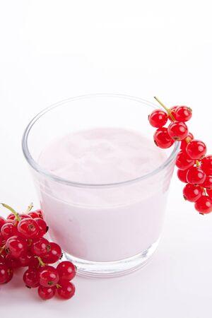 fresh tasty currant yoghurt shake dessert isolated on white background photo