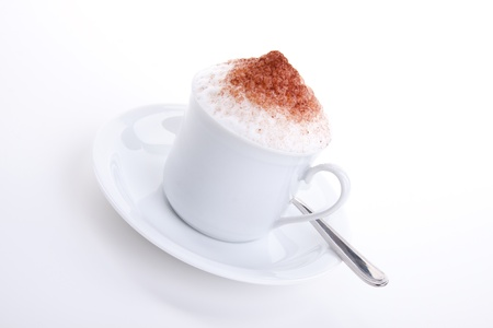 capuccino: fresh capuccino with chocolate and milk foam isolated on white background