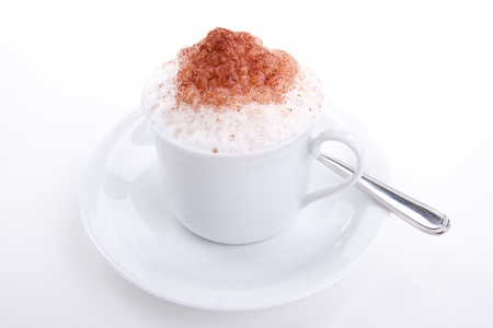 fresh capuccino with chocolate and milk foam isolated on white background photo