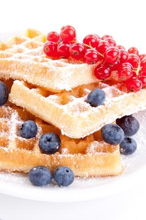 sweet fresh tasty waffles with mixed fruits isolated on white background
