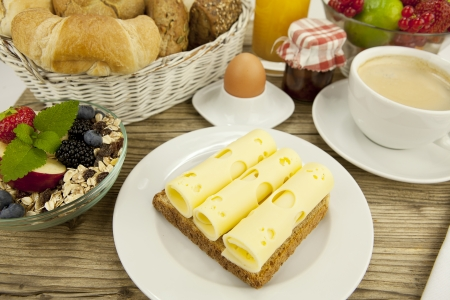 breakfast in morning with fruits  cheese toast coffee on wooden table photo