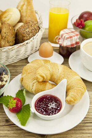 traditional french breakfast in morning on wooden background photo