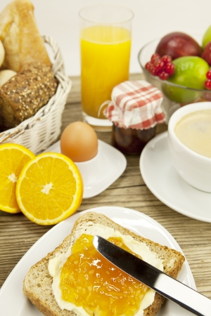 breackfast: tasty breackfast with toast and marmelade on wooden background