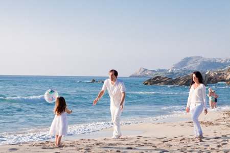 happy young family with daughter on beach in summer lifestyle Stock Photo - 15412798