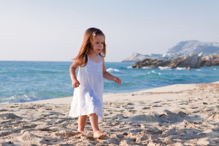 little cute girl smiling playing on beach in summer vacation Stock Photo - 15412813