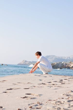 young man is relaxing on beach in summer vacation freedom Stock Photo
