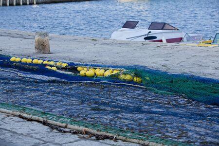 trawl: fishnet trawl rope putdoor in summer at harbour fishing
