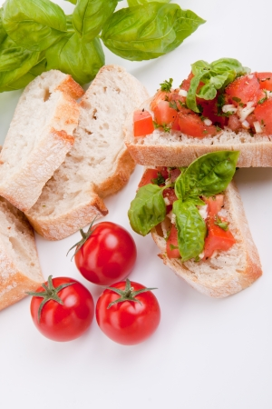 deliscious fresh bruschetta appetizer with tomatoes isolated on white background photo