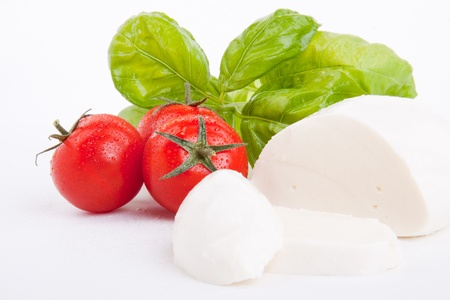 tasty tomatoe mozarella salad with basil isolated on white background