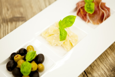 deliscious antipasti plate with parma parmesan olives on wooden background Stock Photo - 15463051