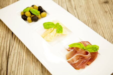 deliscious antipasti plate with parma parmesan olives on wooden background Stock Photo - 15463093
