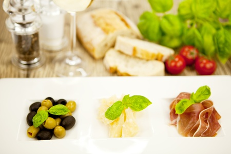 deliscious antipasti plate with parma parmesan olives on wooden background Stock Photo - 15463077