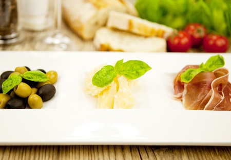 deliscious antipasti plate with parma parmesan olives on wooden background Stock Photo - 15463026