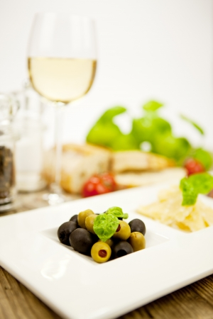 deliscious antipasti plate with parma parmesan olives on wooden background Stock Photo - 15462972