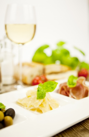 deliscious antipasti plate with parma parmesan olives on wooden background Stock Photo - 15462923