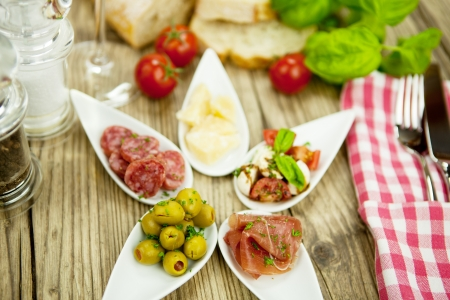 deliscious antipasti plate with parma parmesan olives on wooden background Stock Photo - 15463187