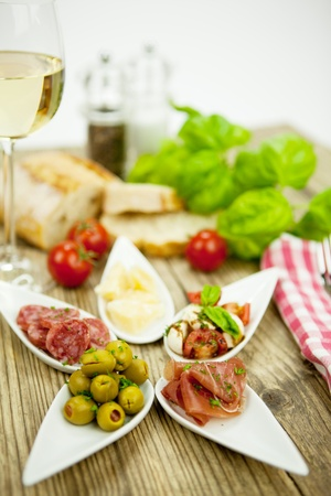 deliscious antipasti plate with parma parmesan olives on wooden background Stock Photo - 15463190