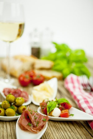 deliscious antipasti plate with parma parmesan olives on wooden background Stock Photo - 15463152