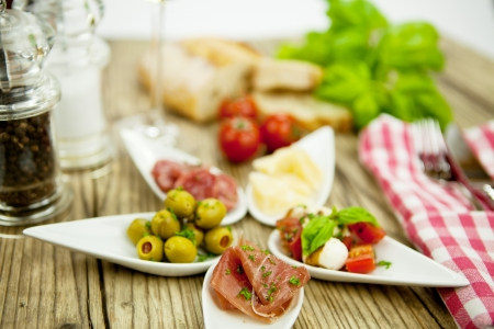 deliscious antipasti plate with parma parmesan olives on wooden background Stock Photo - 15463185