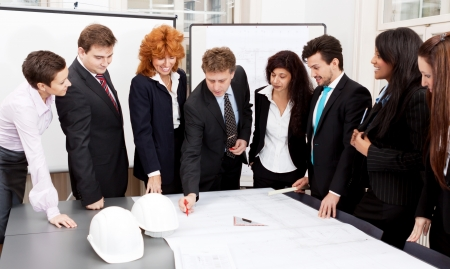 business team looking architecture project in office Stock Photo - 16490045