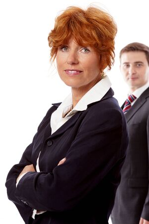 red head woman: red head woman in business outfit  front man in black suit background