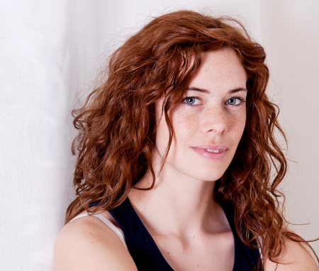 beautiful red head woman with freckled face and blue eyes photo