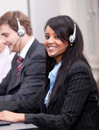personal call: young african business woman talking with headset in callcenter Stock Photo