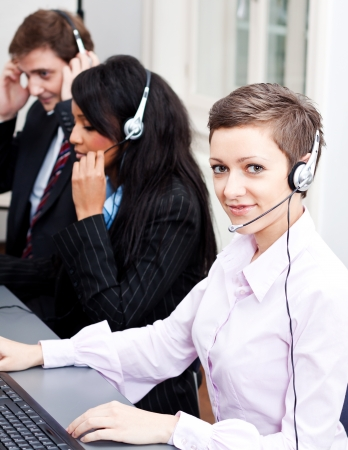 smiling callcenter agent with headset support hotline Stock Photo