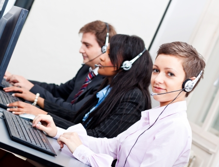smiling callcenter agent with headset support hotline Stock Photo - 17290477
