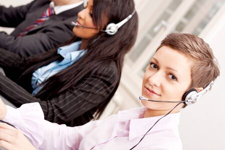 smiling callcenter agent with headset support hotline Stock Photo - 17290801