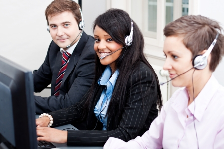 smiling callcenter agent with headset support hotline Stock Photo - 17290473