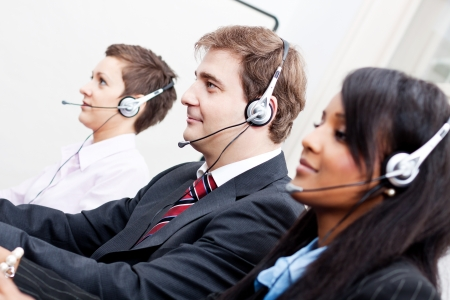 smiling callcenter agent with headset support hotline Stock Photo - 17290757